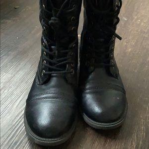 Black combat boots .